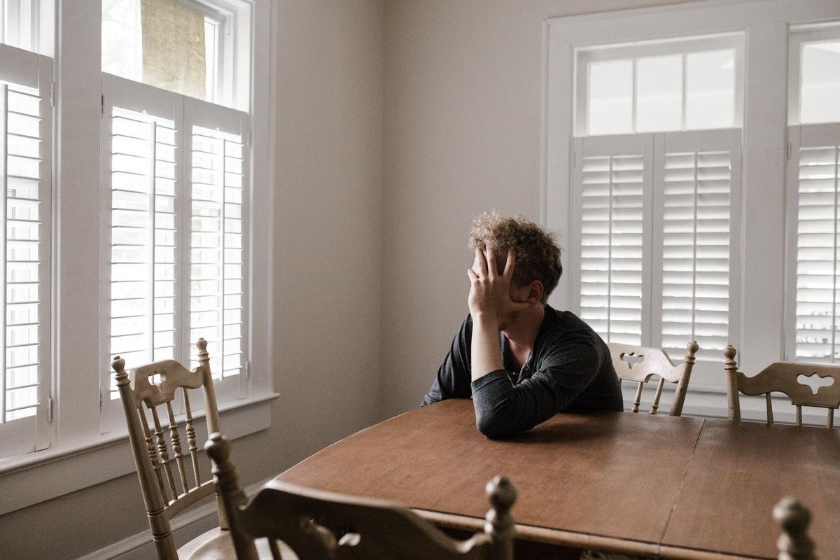 man struggling and sad