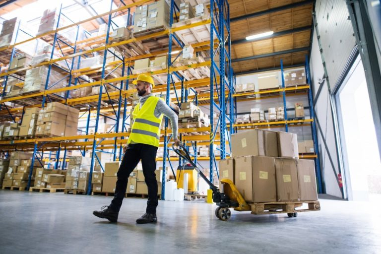 warehouse employee getting boxes from shelves