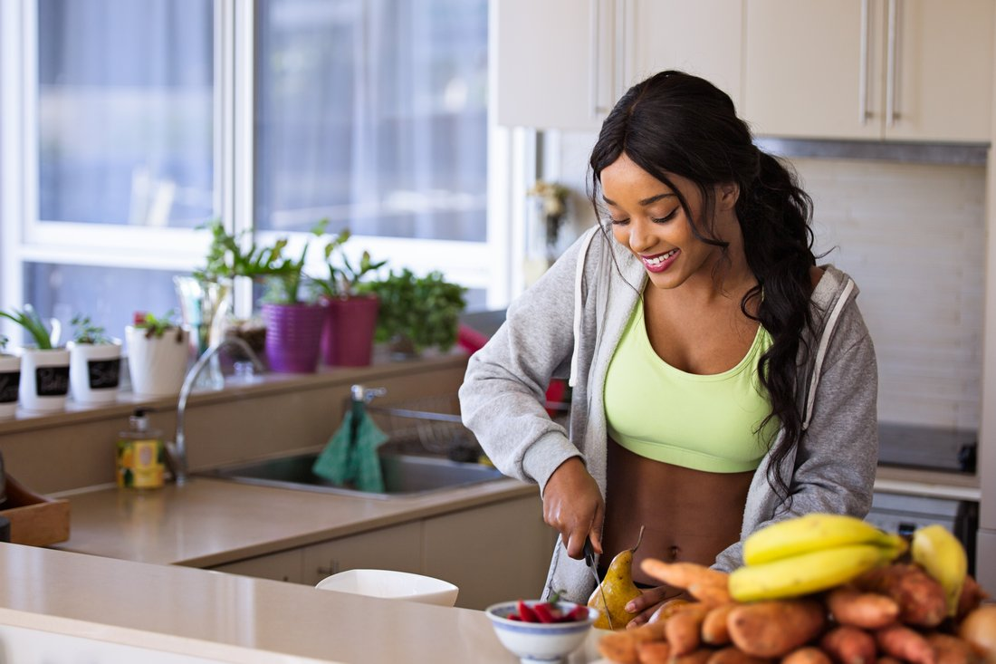 fit woman preparing meal
