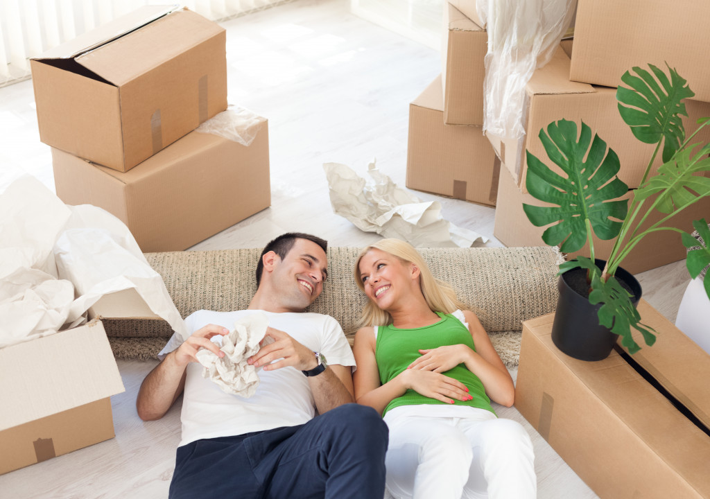 couple unpacking at their new house