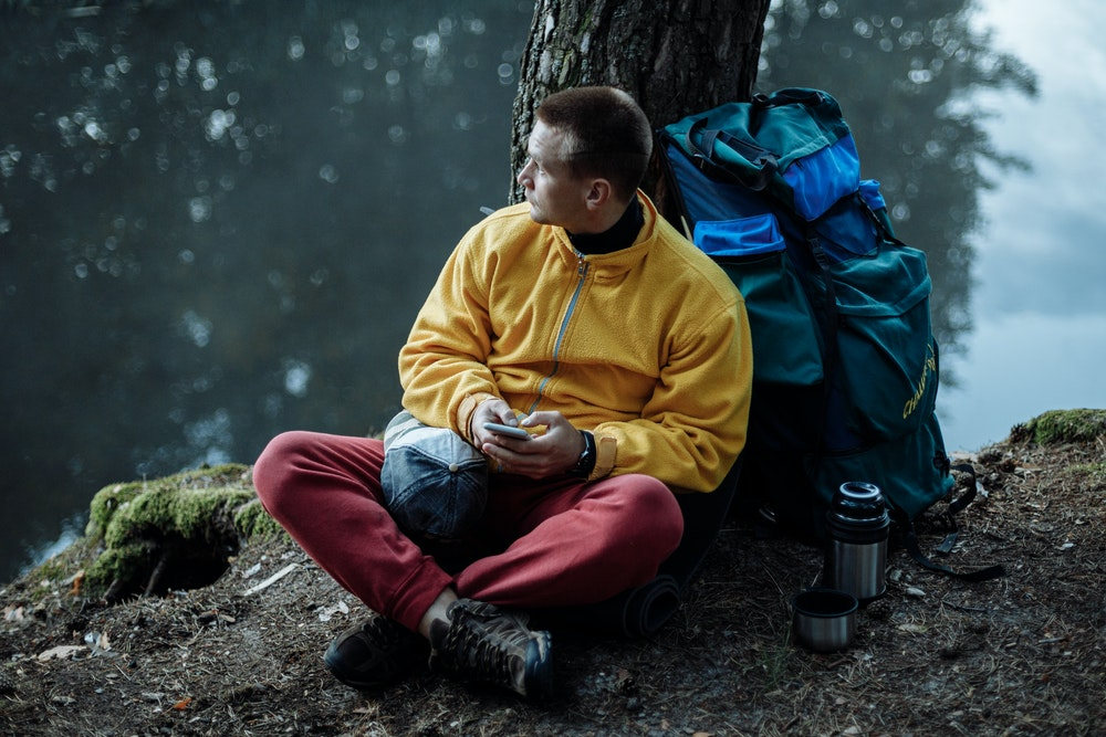 man with camping gear