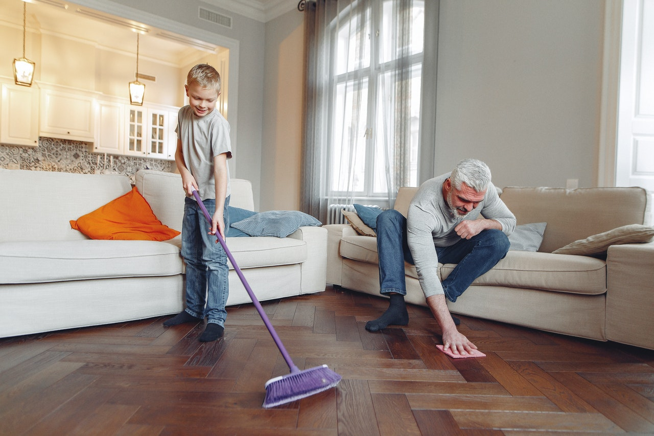 father and son cleaning their home
