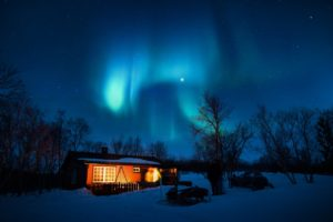 the northern lights above a house