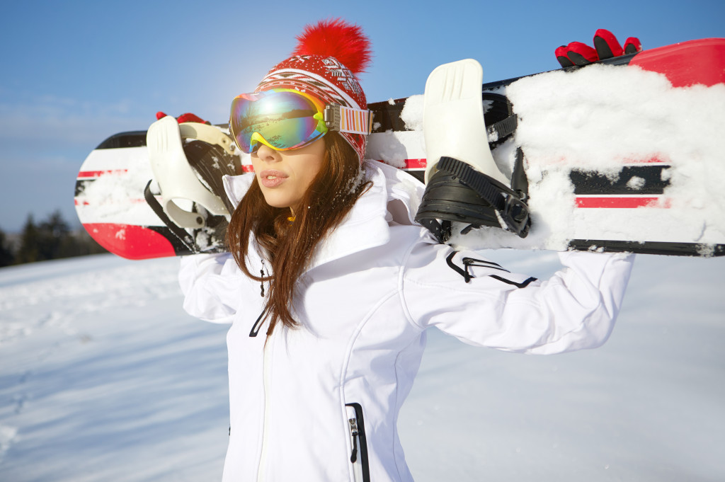 woman holding a snowboard