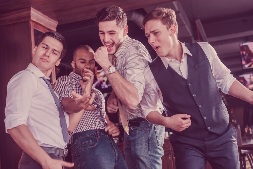 men doing karaoke