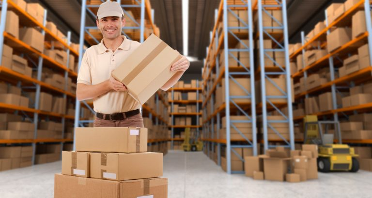 man stacking boxes in warehouse