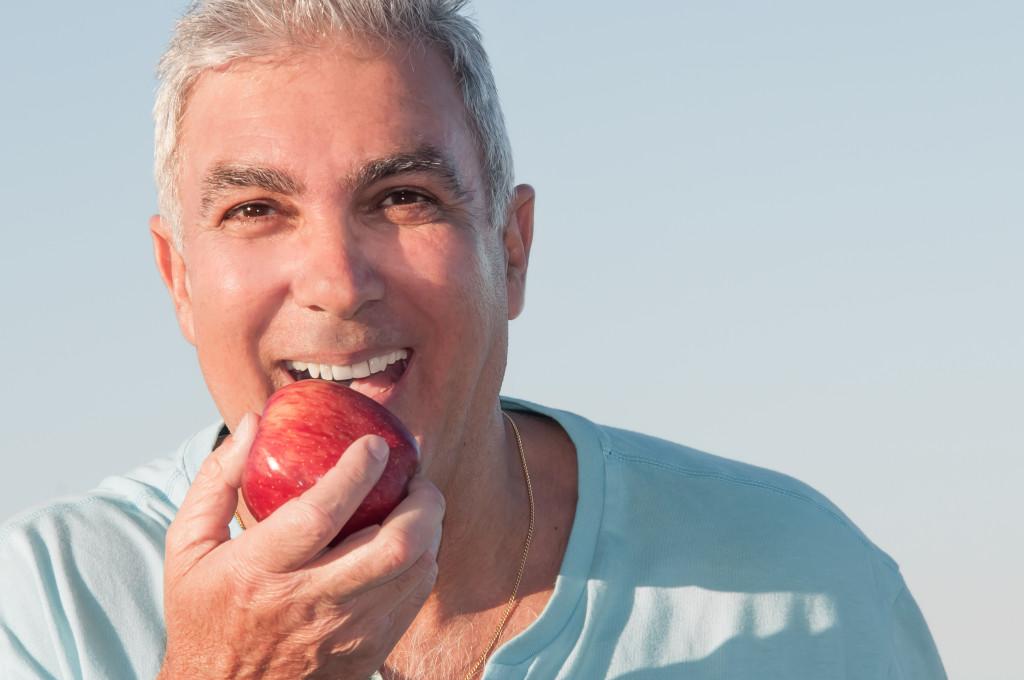 man eating an apple