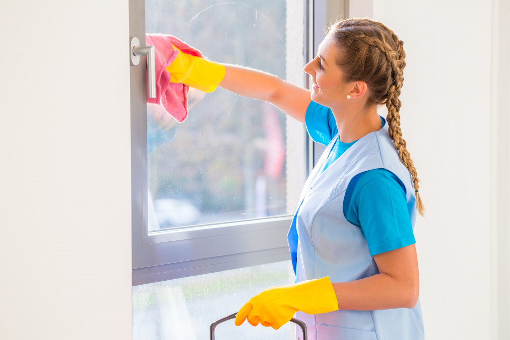 woman cleaning the window pane