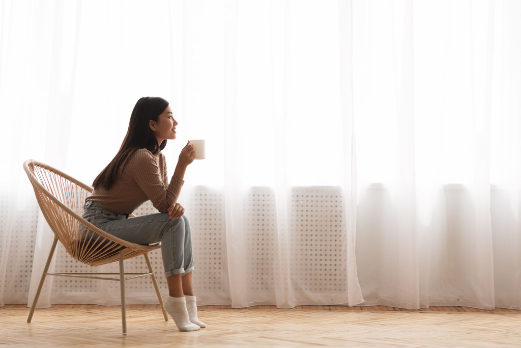 girl sitting in a spacious room